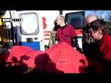 Ополченцы передают трупы и 1 выжившего украинского карателя